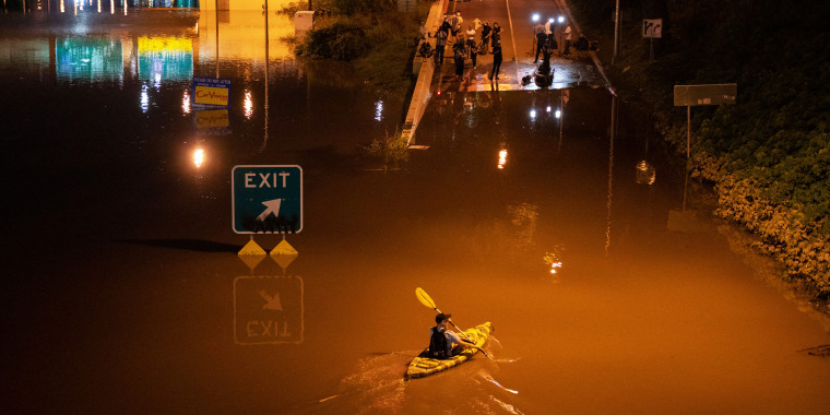 A kayaker paddles down a portion of Interstate 676 after flooding from heavy rains from hurricane Ida in Philadelphia on Sept. 2, 2021.