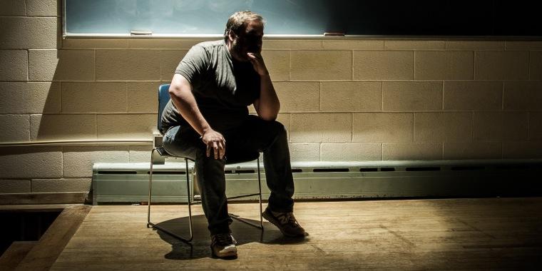 Man Thinking in a Dark, Moody Classroom