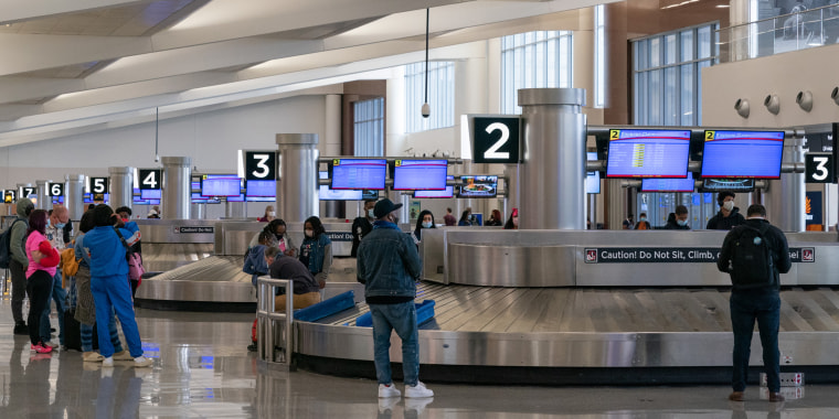 Image: Passengers wait for their luggage at Hartsfield-Jackson Atlanta International Airport on April 8, 2021.