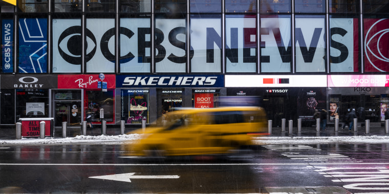 Image: A taxi drives past CBS News signage on the ViacomCBS headquarters in New York, on Feb. 19, 2021.