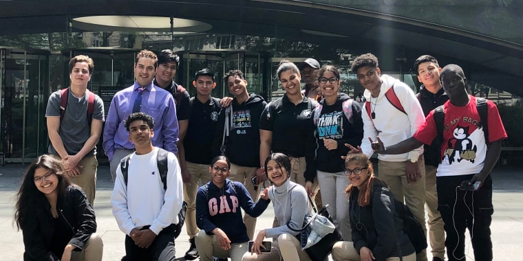 Alejandro Mundo and his classroom students outside the Rose Center for Earth and Space in 2019.