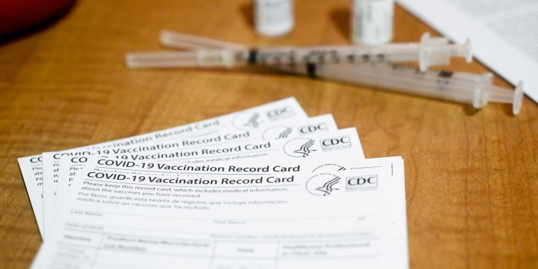 Blank CDC-issued Covid-19 vaccination record cards are set out on a table at the Berks Heim Nursing and Rehabilitation Center in Bern Township, Pa., on Jan. 29, 2021.