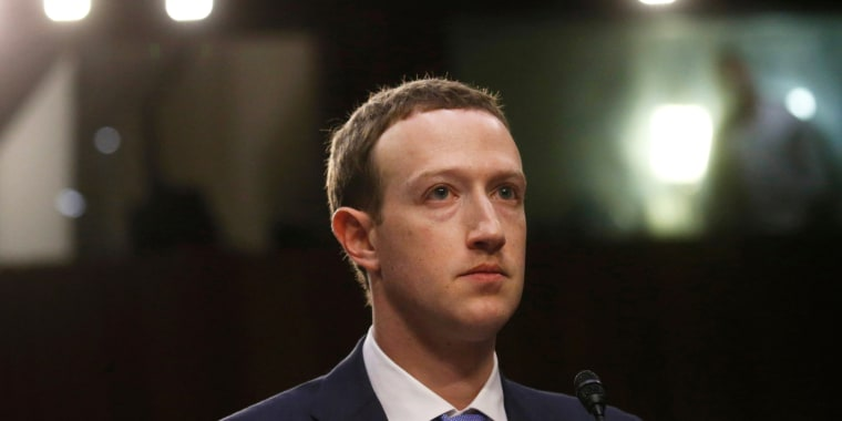 Facebook CEO Mark Zuckerberg listens while testifying before a joint Senate hearing regarding the company's use and protection of user data on Capitol Hill on April 10, 2018.