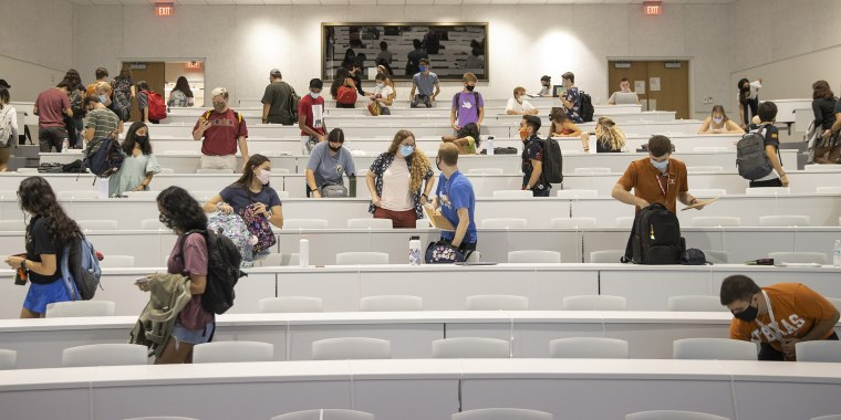 Image: Students leave after a class at University of Texas at Austin on Aug. 26, 2020.