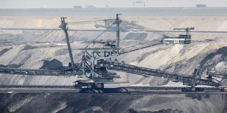 Giant bucket-wheel excavators extract coal at the controversial Garzweiler surface coal mine near Jackerath, west Germany, on April 29, 2021.