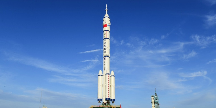 A Long March-2F carrier rocket, carrying the Shenzhou-12 spacecraft for China's first manned mission to its new space station, stands at the Jiuquan Satellite Launch Centre in the country's northwestern Gansu province on June 9, 2021.