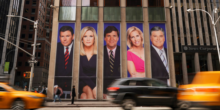 Advertisements featuring Fox News personalities Bret Baier, Martha MacCallum, Tucker Carlson, Laura Ingraham, and Sean Hannity adorn the front of the News Corporation building on March 13, 2019, in New York.