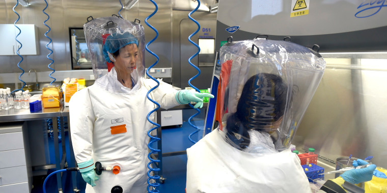 A virologist works with her colleague in the P4 lab of Wuhan Institute of Virology in Wuhan in central China's Hubei province