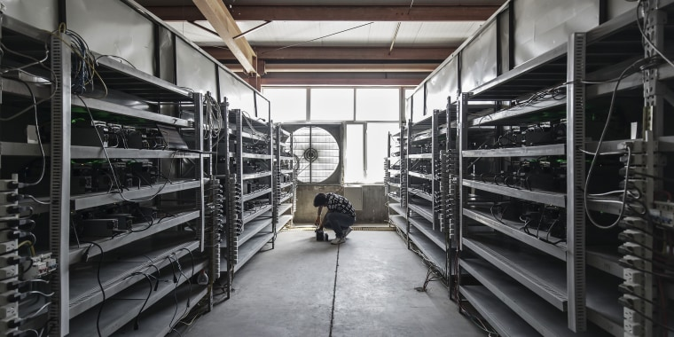 A technician inspects bitcoin mining machines at a mining facility operated by Bitmain Technologies Ltd. in Ordos, Inner Mongolia, China, on Aug. 11, 2017.
