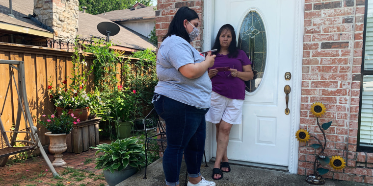 Image: Guadalupe Torres, left, schedules a Covid-19 vaccine appointment for Maria Cruz Meza and her family  in Dallas on July 21, 2021.