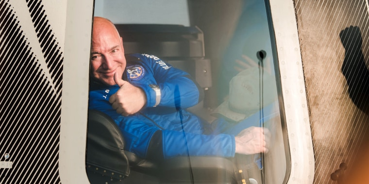 """Jeff Bezos gives the """"thumbs up"""" after returning from space on July 20, 2021."""