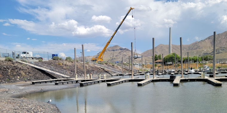 Image: A sailboat is removed from the Great Salt Lake Marina  in Utah due to low lake levels.
