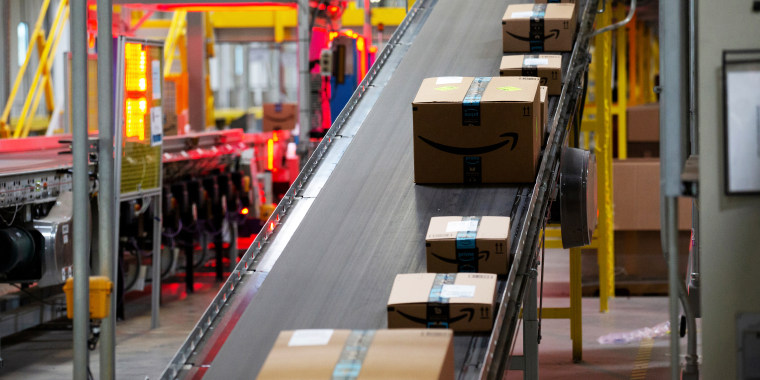 Packages move along a conveyor at the Amazon fulfillment center in Robbinsville, N.J., on June 7, 2018.