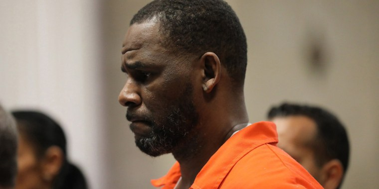 In this file photo taken on September 16, 2019 singer R. Kelly appears during a hearing at the Leighton Criminal Courthouse in Chicago, Illinois. - R. Kelly onSeptember 27, 2021 was convicted of leading a decades-long sex crime ring, with a New York jury finding the superstar singer guilty on all nine charges, including racketeering. (Photo by Antonio PEREZ / POOL / AFP) (Photo by ANTONIO PEREZ/POOL/AFP via Getty Images)