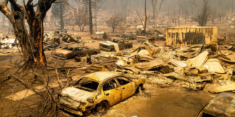 Image: Cars and homes destroyed by the Dixie Fire line central Greenville on Thursday, Aug. 5, 2021, in Plumas County, Calif.
