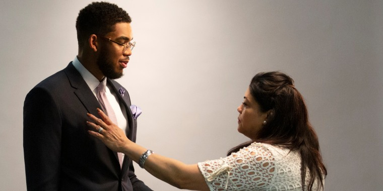 Jacqueline Cruz makes sure her son Karl-Anthony Towns looks good for his official team pictures after being named NBA Rookie of the Year in 2016.