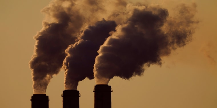 Emissions rise from the smokestacks at the Jeffrey Energy Center coal power plant on Sept. 18, 2021, near Emmett, Kan.