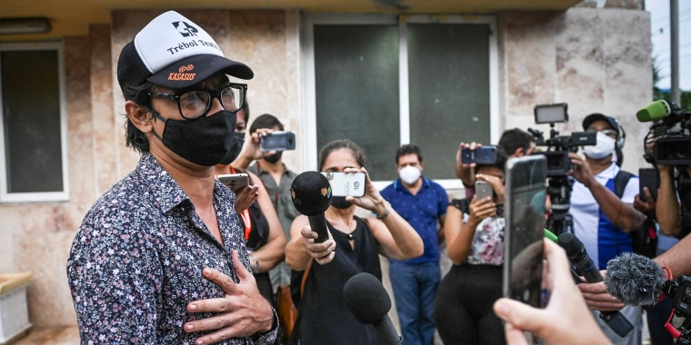 Image: Cuban actor, playwright and opposition activist Yunior Garcia Aguilera talks to the press on his way out of the Havana Provincial Prosecutor's Office, on Oct. 21, 2021.