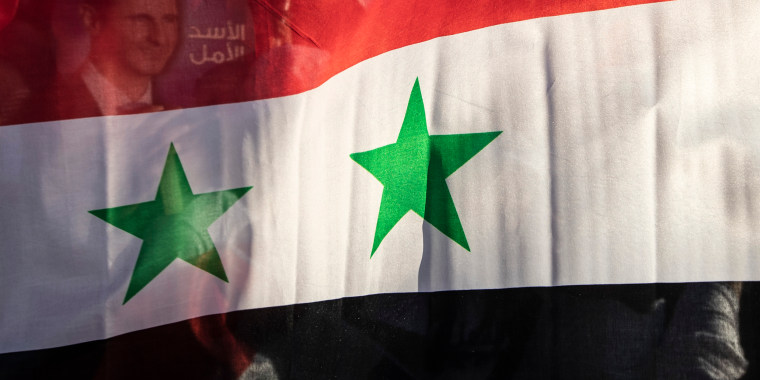 The Syria national flag is displayed at a gathering at Omayyid Square in the Syrian capital Damascus on May 23, 2021.