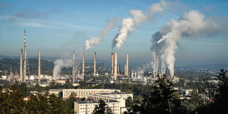 Image: Smoke rises from the Feyzin Total refinery chimneys, outside Lyon, central France on Oct. 15, 2021.