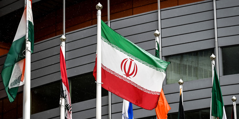 The Iranian flag waves in front of the International Atomic Energy Agency (IAEA) headquarters in Vienna on May 23, 2021.