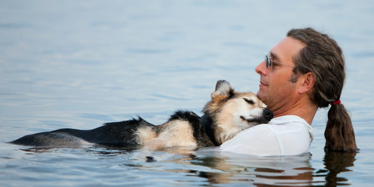 John Unger and his dog Schoep float anywhere from 10 minutes to an hour, depending on the temperature of the water and how Schoep is feeling.
