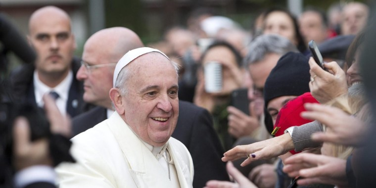 epa03972946 Pope Francis greets Italian faithful during a visit to Saint Cirillo Alessandrino's church in Rome, Italy, 01 December 2013. During his vi...