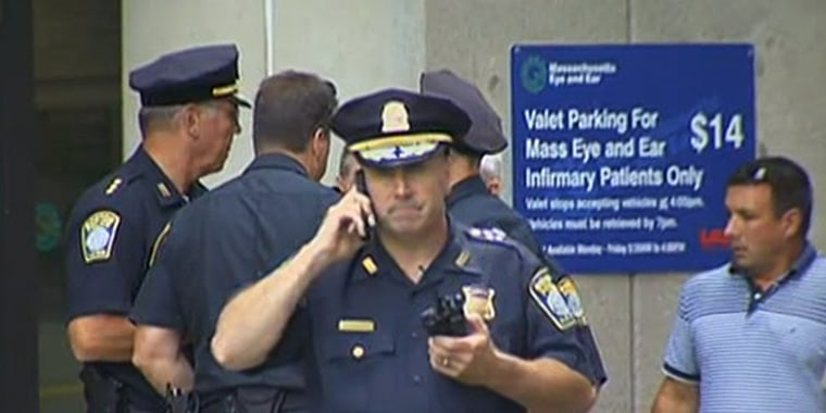 Police officers stand outside Massachusetts Eye and Ear Infirmary in Boston  on Wednesday.