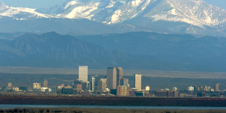 At top, on a clear morning, the downtown Denver skyline with the front range peaks of the Rocky Mountains in the background and Cherry Creek Reservoir...