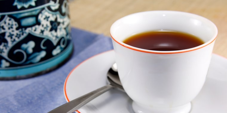 Cup of hot tea in a white cup and saucer.
