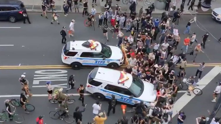 New York City police vehicles filmed driving into crowds of protesters