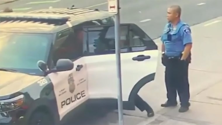 New video shows Minneapolis officers appear to struggle with George Floyd in back of patrol car