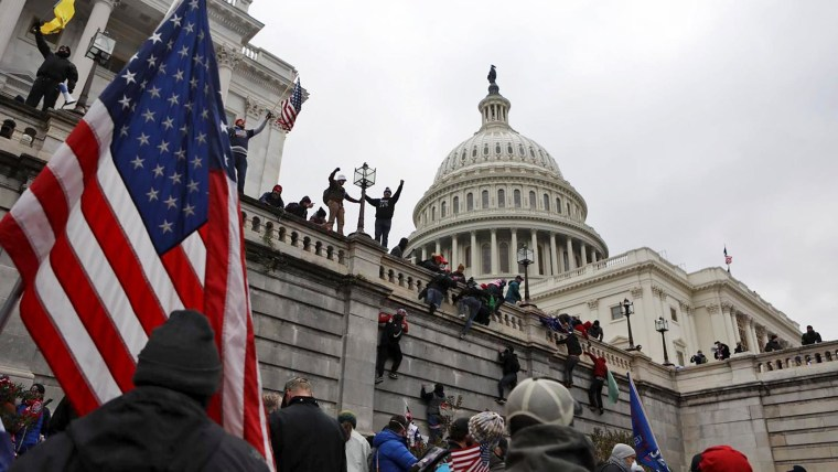Photos and videos show pro-Trump protesters storming U.S. Capitol
