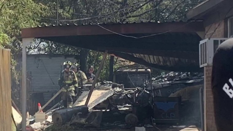 At least two injured when military plane crashes in Texas backyard