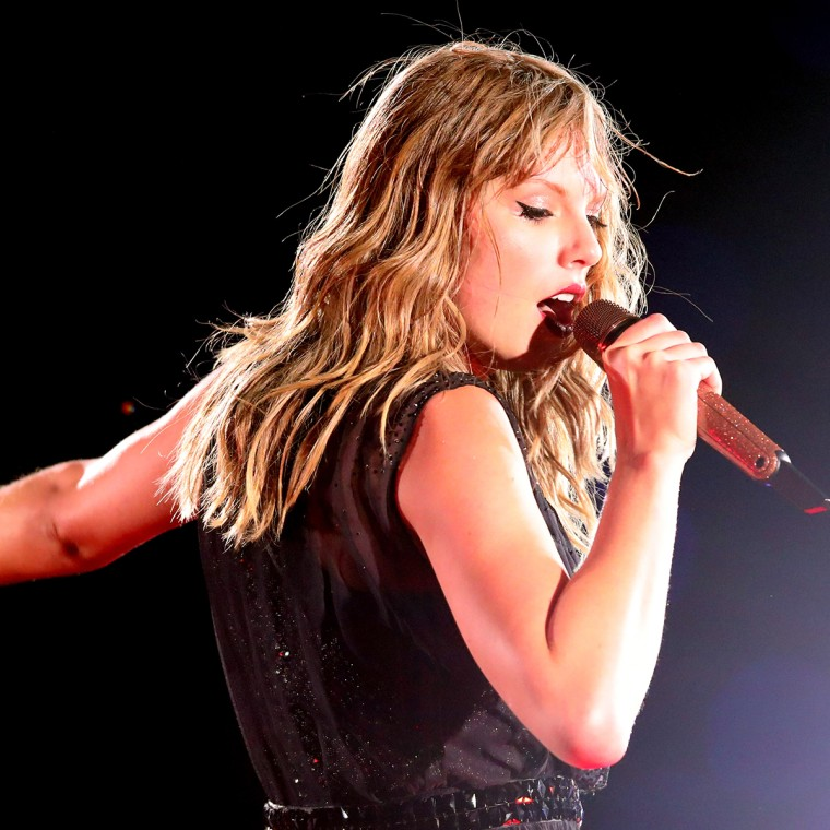 Taylor Swift tearing up on stage on the anniversary of her sexual assault trial.