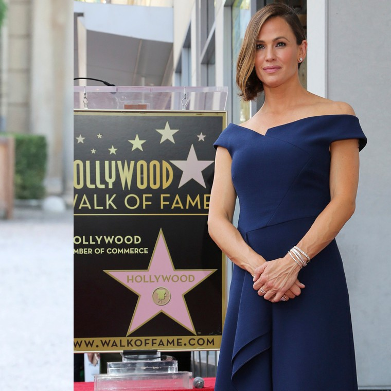 Jennifer Garner channeled Meghan Markle on the Hollywood Walk of Fame	jennifer_-garner-meghan-markle-dress-alike-today-main-split-02-180821.jpg  Caption: Actress Jennifer Garner poses at a ceremony honoring her with a star at the Hollywood Walk of Fame on