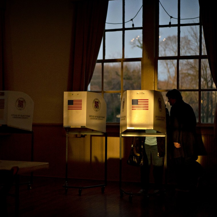 Image: A voter casts their ballot at a polling station in Hillsboro, Va., on March 3, 2020.