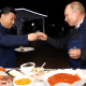 Image: Russian President Vladimir Putin and Chinese President Xi Jinping toast during a visit to the Far East Street