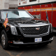 """Image: Secret Service agent cleans U.S. President Donald Trump's new Cadillac limousine nicknamed """"The Beast"""" before debut drive in New York City"""