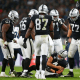 Derek Carr #4 of the Oakland Raiders holds his arm as he lies injured in the ground after taking a hit during the NFL International Series game between Seattle Seahawks and Oakland Raiders at Wembley Stadium on Oct. 14, 2018 in London.