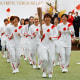 Image: Members Japan's women's national soccer team lead the torch relay during the Tokyo 2020 Olympic Torch Relay Grand Start in Naraha