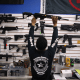 Image: Mike Acevedo puts a weapon on display at the National Armory gun store on April 11, 2013 in Pompano Beach, Fla.