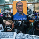 Image: Protesters march around downtown Minneapolis near the courthouse calling for justice for George Flyod after closing arguments in the Chauvin trial has ended