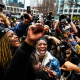 People celebrate as the verdict is announced in the trial of former police officer Derek Chauvin outside the Hennepin County Government Center in Minneapolis on April 20, 2021.