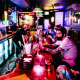 Customers sit at the bar at Wilson Lives! in the Brooklyn borough of New York on May 3, 2021.