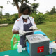 Nurse Natalie Victa prepares to administer the vaccine to patients on Namatale Island, Uganda.