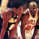 Los Angeles Lakers guard Kobe Bryant and Chicago Bulls guard Michael Jordan talk during a free-throw attempt during the fourth quarter of a game at the United Center in Chicago on Dec. 17, 1997.