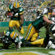 Image: Green Bay Packers running back Najeh Davenport (44) scores against the New Orleans Saints at Lambeau Field in Green Bay, Wisc., on Oct. 9, 2005.