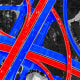 Photo illustration: Aerial view of red and blue colored highways crossing over each other.