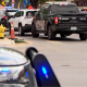 Image: Police vehicles at the scene of an officer involved shooting in Olde Town Arvada, Colo., on June 21, 2021.